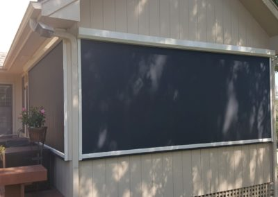 motorized SOLAR screens installed over existing stationary screens